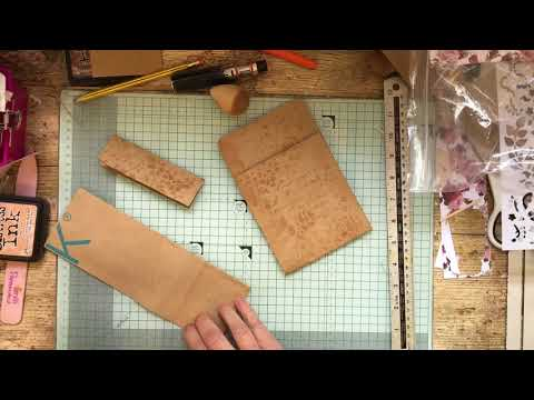 Loaded pocket from a brown paper bag for junk journals