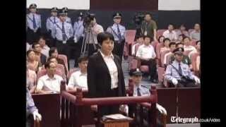 Bo Xilai's wife Gu Kailai stands in seven hour trial in China