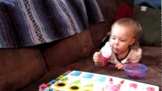 Sadie reading and eating strawberries 2-10-12 Thumbnail