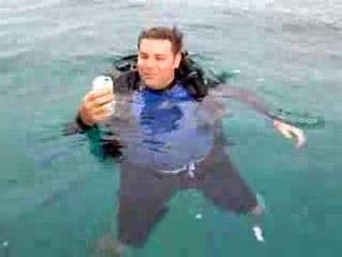 Diver has a beer after last dive of day