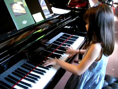 8 Year Old Umi Garrett Tries Out the August Forster Piano