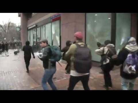 Protesters smash windows as violence breaks out ahead of Donald Trump inauguration