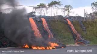 11/12/2014 -- Hawaii Lava Flow reaches Transfer Station -- Flowing downhill to Road