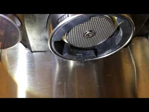 How to remove and clean the upper filter from a Breville espresso maker