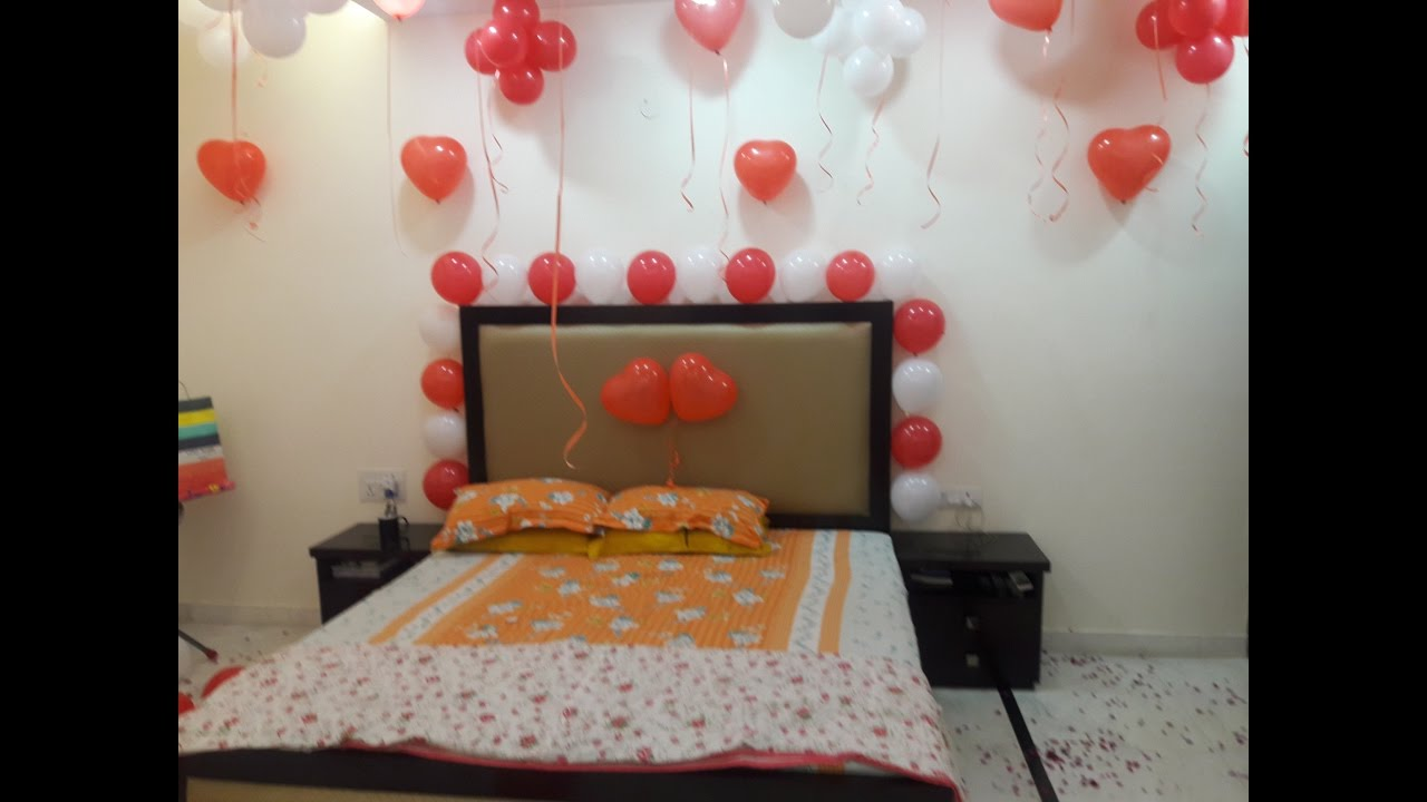 Surprise room decoration balloon decoration in room for Bed decoration with flowers and balloons