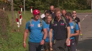 Prince Harry joins injured veterans on a hike for Walking With The Wounded
