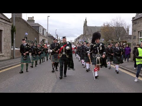 Combined pipe bands lead parade through Inverurie, Scotland for 2018 Christmas Lights switch-on