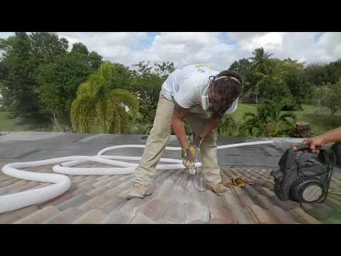 Cutting roof tile for solar attic fan.
