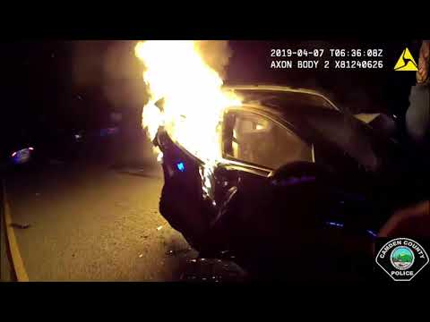 Dramatic video shows officers pulling victims out of burning car before it's engulfed in flames