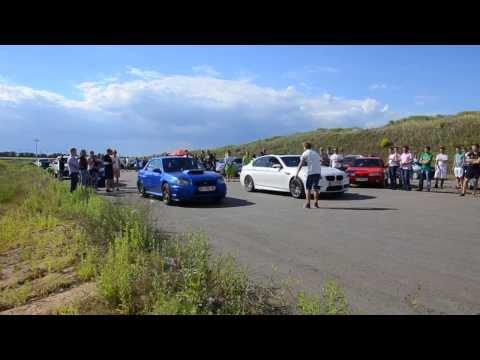 BMW M5 F10 vs Subaru WRX STi