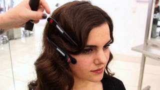 Inspired by the 1920s and the recent 2013 film adaptation of The Great Gatsby, Toni and Guy stylist & educator Darian breaks down how to do a 1920s inspired updo called the faux bob.   This hairstyle is great for mid length to long hair and simulates having a bob.   Interested in beauty school or becoming a hairstylist?  Click here - http://bit.ly/WNsVEf - to find out more about attending Toni and Guy Academy & cosmetology school.   Toni and Guy Academy's cosmetology program prepares beauty school students to pass state board equipping them with a strong hair cutting and hair colouring foundation.  Toni and Guy Academy has 26 locations across the U.S. and has a reputation in the hair industry for produces salon-ready graduates.  Become a stylist - http://ow.ly/ti07S  Connect with on social! http://www.facebook.com/toniandguy Twitter @ToniGuyUSA http://pinterest.com/ToniGuyUSA/ Toni and Guy Blog - http://ow.ly/cY3Qi
