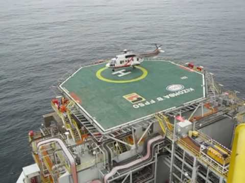 Helicopter landing offshore Africa