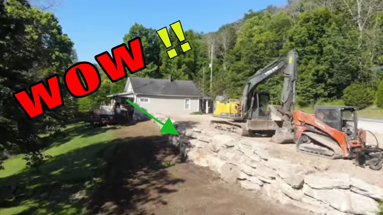 Completed the retaining wall wow it turned out awesome and channeling my inner logger wade