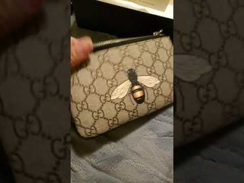 d93b8e4f8f7 Gucci Supreme GG Bee Wristlet - YouTube