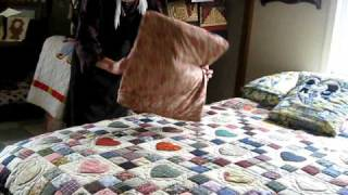 Amish Girl Showing Me How To Fold The Pillow-quilt Thing
