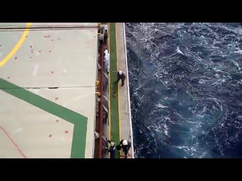 Seafarers working on deck at sea