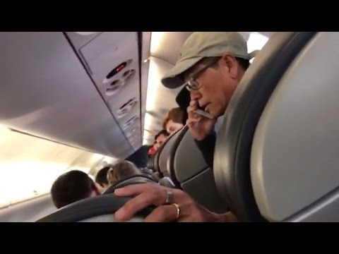 Thumbnail: New video United Airlines passenger before removal is released