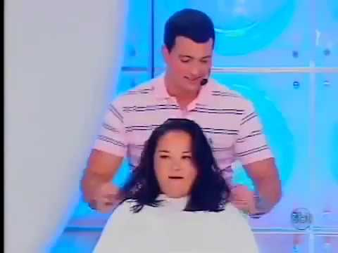 Woman cuts her long hair in Brazil