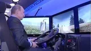 Путин учится ездить на Камазе с инструктором