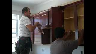 A how to video of installing a production cabinet kitchen in a production stick framed house.