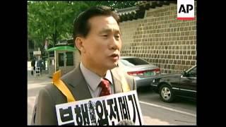 Anti-NKorea protesters burn flag outside NKorean embassy