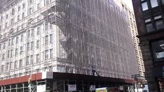 New York City upclose - large building encased in scaffolding