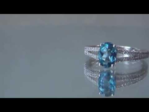 кольцо золотое 14 кр  с топазом
