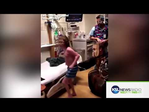 Doctor Tells Child about a New Heart Dressed as Chewbacca