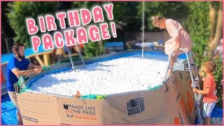jumping-into-her-giant-birthday-package