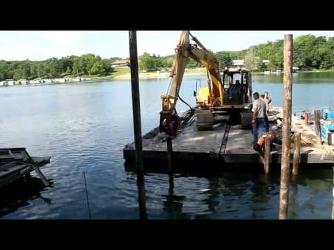 pile driving off a sectional spud barge - YouTube