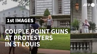 Couple Point Guns At Protesters Outside Their House In St Louis | Afp