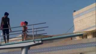 A 3 year old jumping from the highest diving board