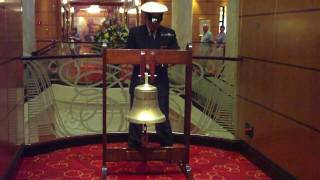 QM2 Ringing the ship's bell at midday