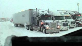 Truck stop mainia in snow. thumbnail
