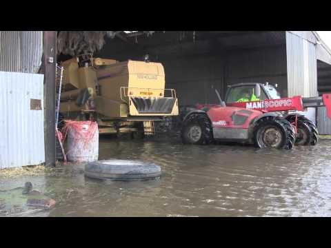 Farmers Haul Combine Harvester From Somerset Floods
