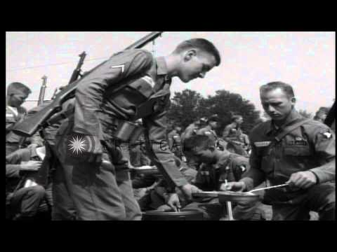 US 101st Airborne Division guards escort African American students at Little Rock...HD Stock Footage