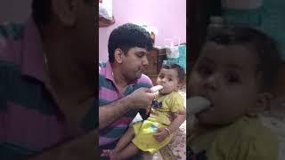 Malu baby eating ice cream with Papa