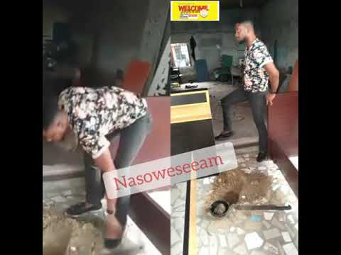 A Nigerian man who is also a carpenter was caught red-handed burying charms in front of his shop.