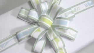 Repeat youtube video Cómo hacer un moño de papel para regalos - manualidadesconninos