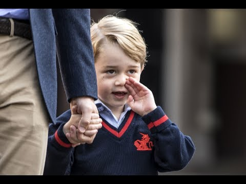 Prince George arrives for his first day at...