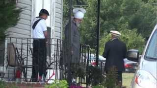 Hazrat Mirza Masroor Ahmad ABA outside his house at Bait ur Rehman USA