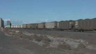 "KCS ""Southern Belle"" SD70ACe leading BNSF coal train"