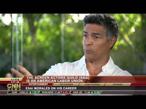 Kristian Valen as CNN Richard Quest with NYPD Blue star Esai Morales