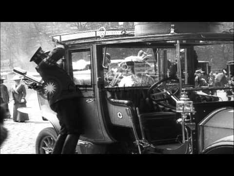 King George V and Kaiser Wilhelm II enter a royal carriage in front of a building...HD Stock Footage