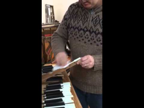 Cleaning the ivory keys of your piano