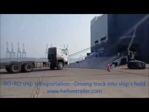 Truck trailer by RO-RO ship transportation( driving truck into the ship's hold)