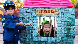 Emma pretend play as a cop and pretends to put people in her jail p...