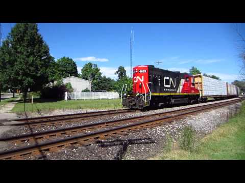 CN local train headed West behind Grand Trunk Western GP9R diesel loco.