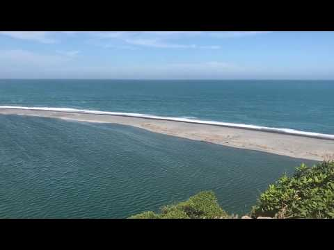 River Hurunai (New Zealand) merging in pacific ocean