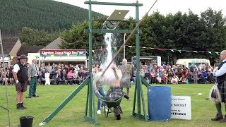 Tilt The Bucket Open Challenge During The 2019 Ballater Highland Games In Aberdeenshire Scotland